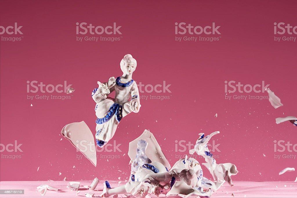 Porcelain statue explodes stock photo