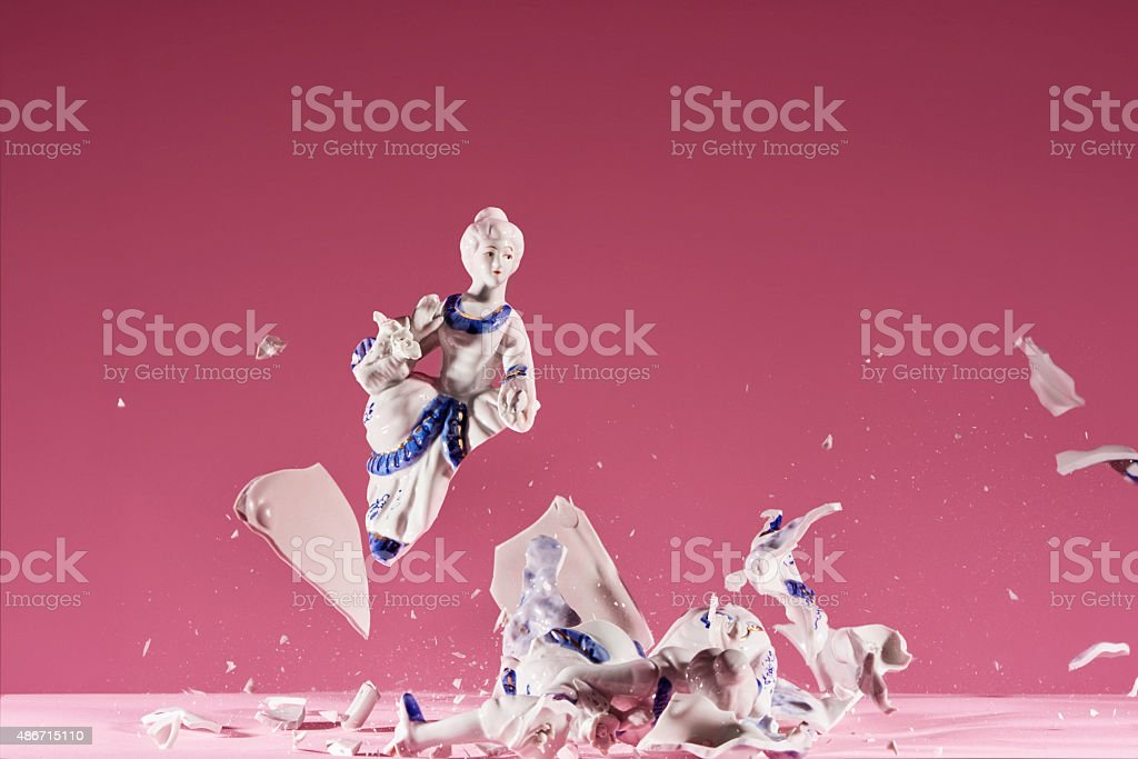 Porcelain statue explodes stock photo