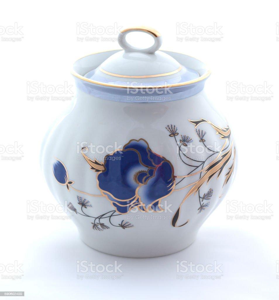 Porcelain sugar bowl on a white background stock photo