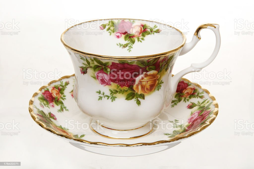 porcelain tea cup with floral design stock photo