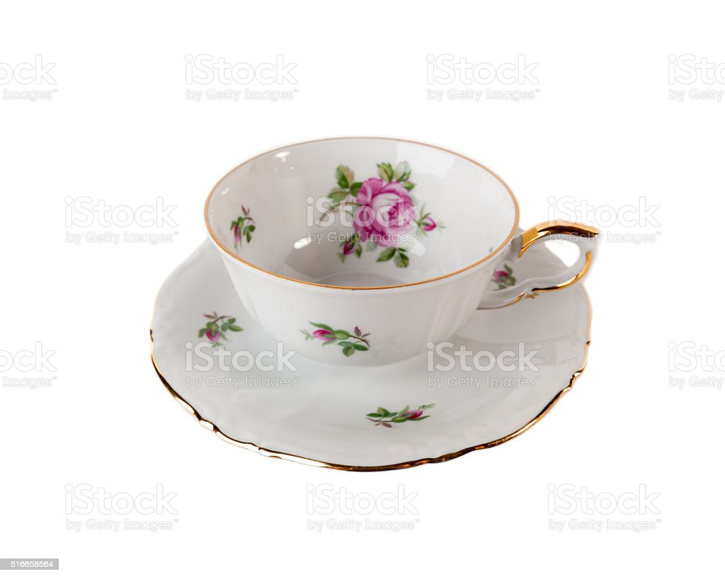 Porcelain teacup and saucer on white stock photo