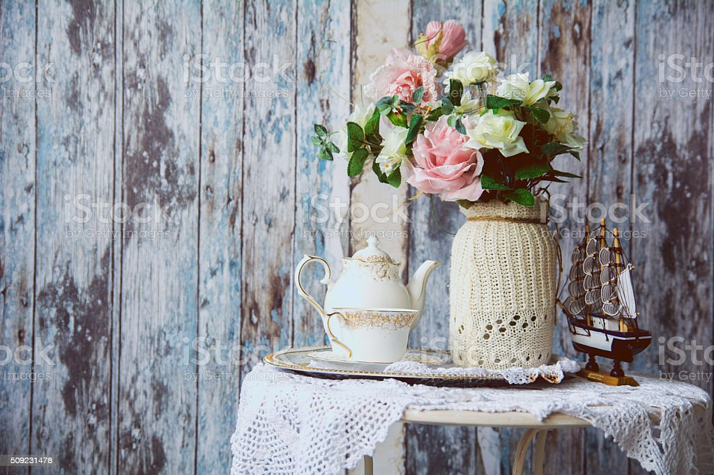 Porcelain teapot and cup on a table stock photo