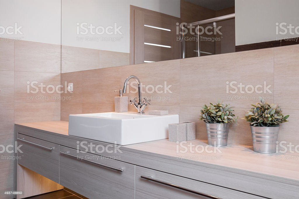 Porcelain washbasin in bright bathroom stock photo