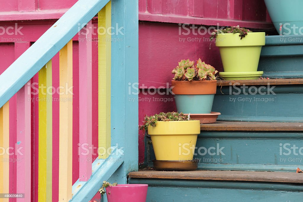 Porch Railing Steps Potted Plants stock photo
