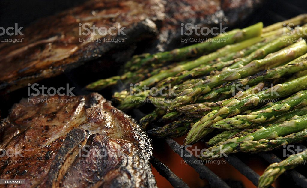 pork and asparagus grilled stock photo