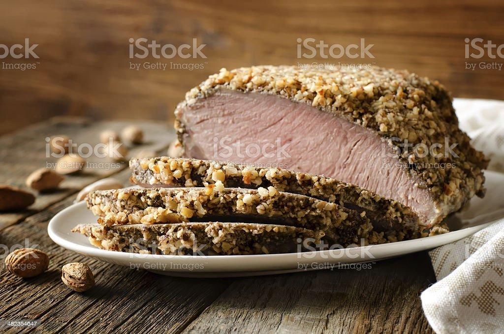 pork baked in almond crumb stock photo