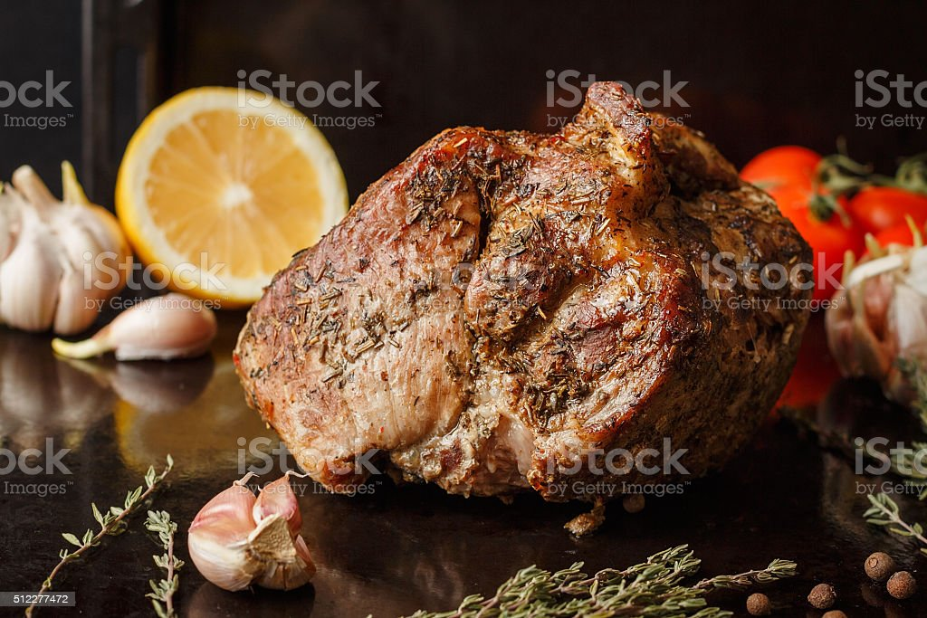 Pork baked with herbs stock photo
