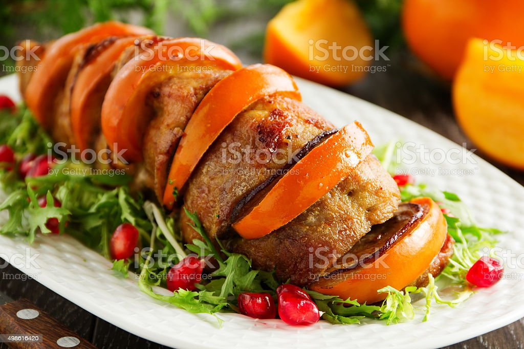 Pork baked with persimmons. stock photo