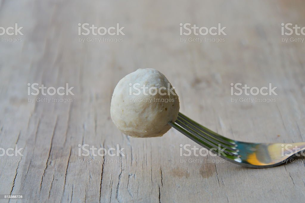 pork ball stab in fork stock photo