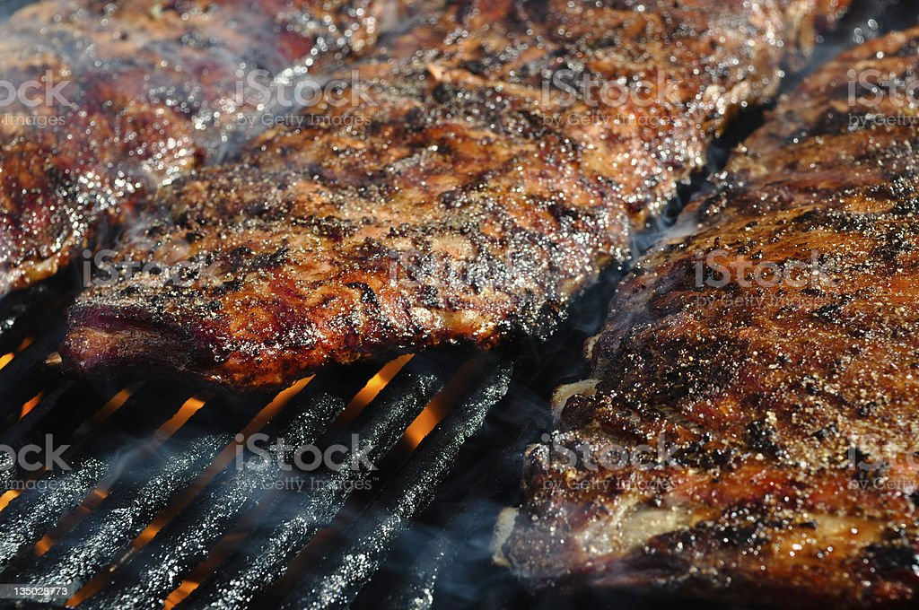 Pork barbecue ribs on the grill stock photo