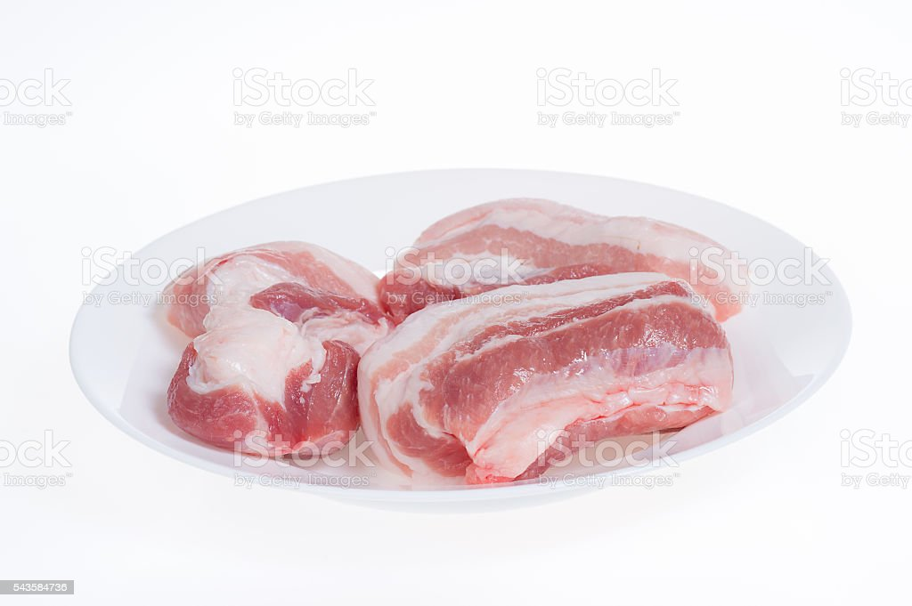 Pork belly on white plate isolated on white background stock photo