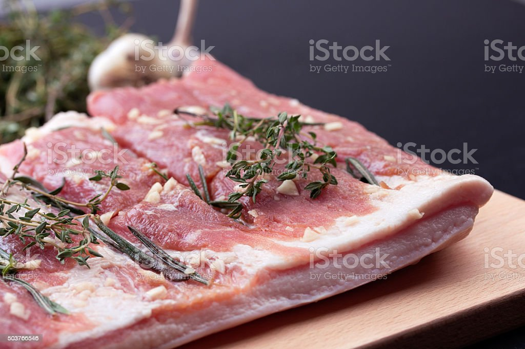 Pork belly with herbs spices stock photo