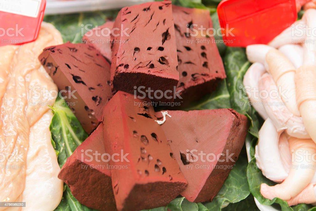 pork blood cake at butcher shop boqueria market barcelona spain stock photo
