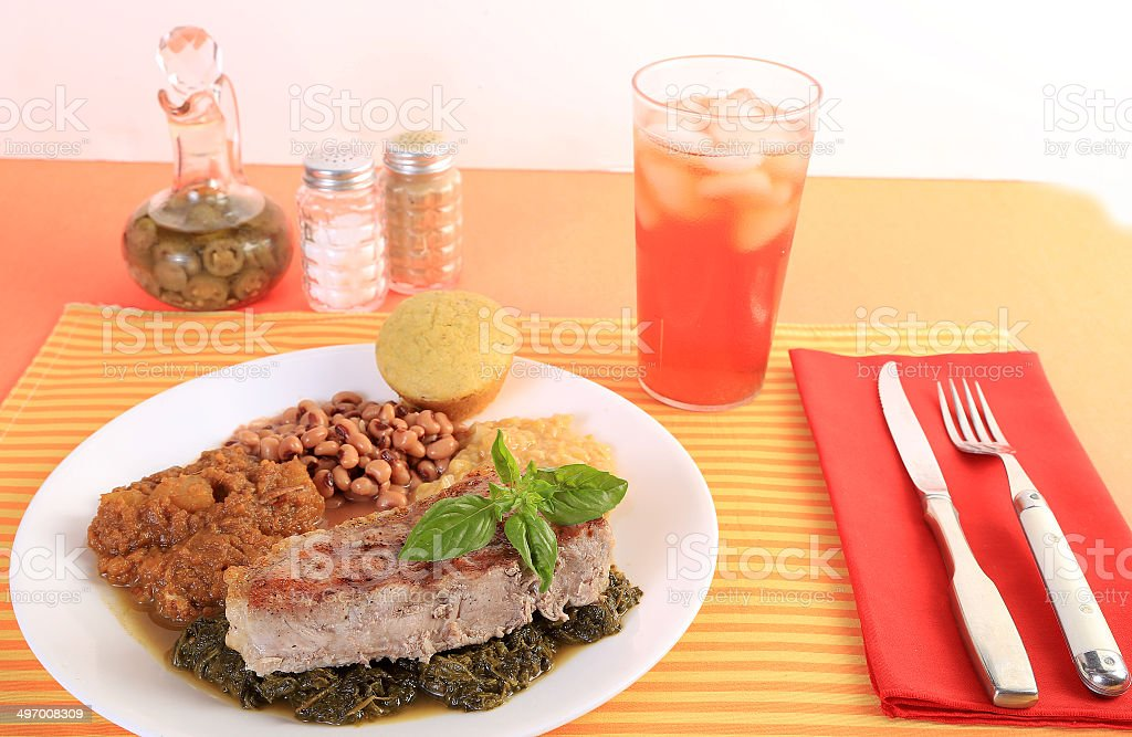 Pork Chop and Collard Greens stock photo