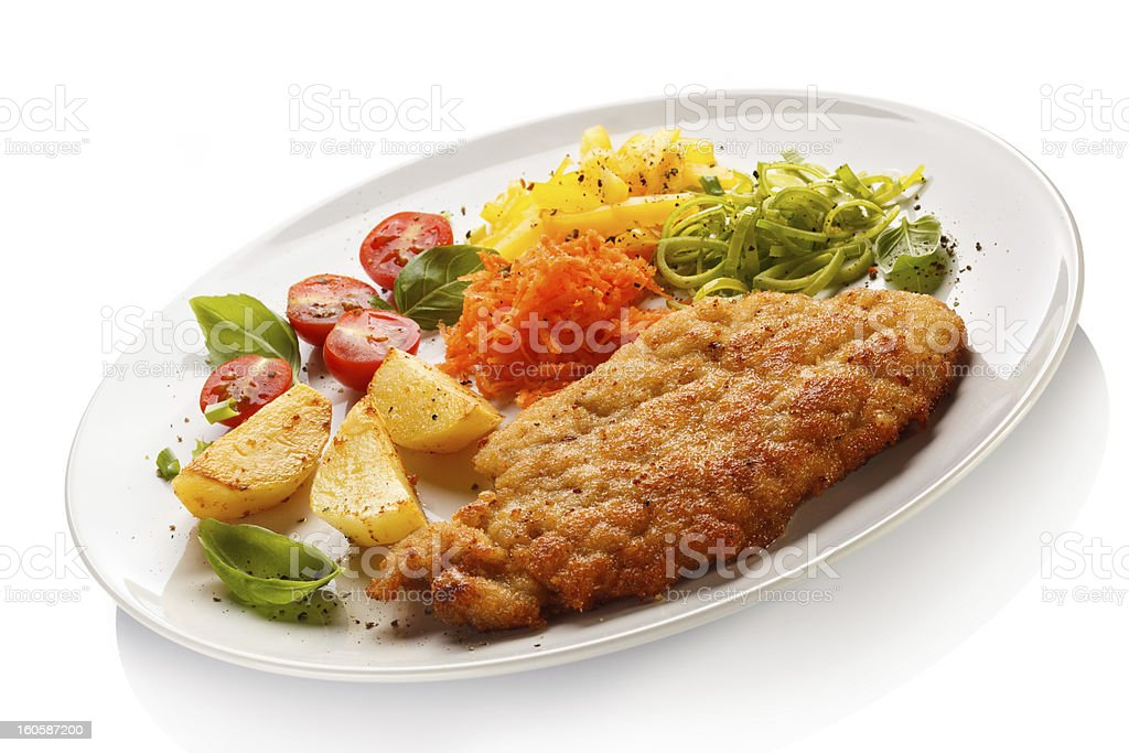Pork chop, baked potatoes and vegetables royalty-free stock photo