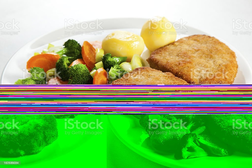 Pork chop dinner with veg on a plate with interference lines royalty-free stock photo