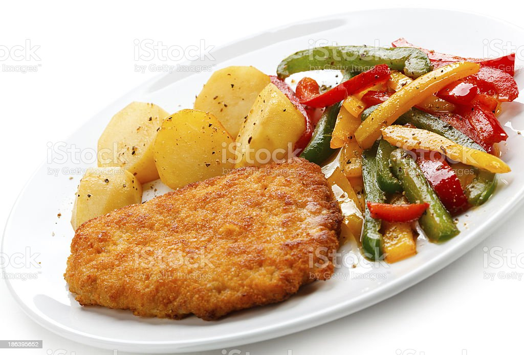 Pork chop, French fries and vegetables royalty-free stock photo