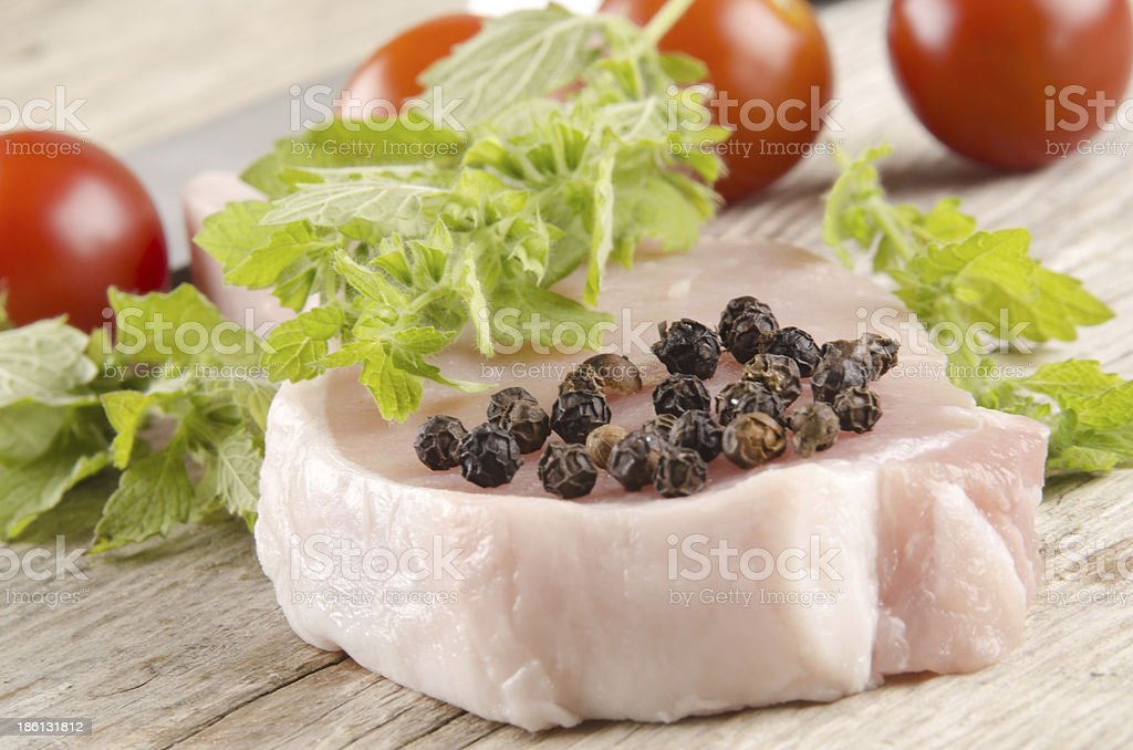 pork chop on a wooden table royalty-free stock photo