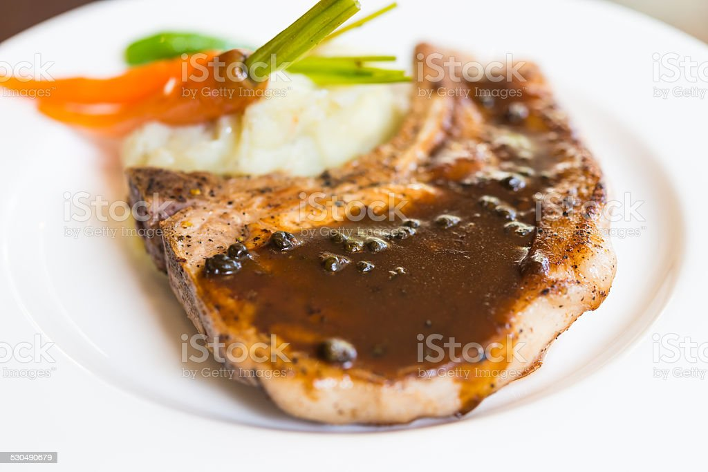 Pork chop steak stock photo