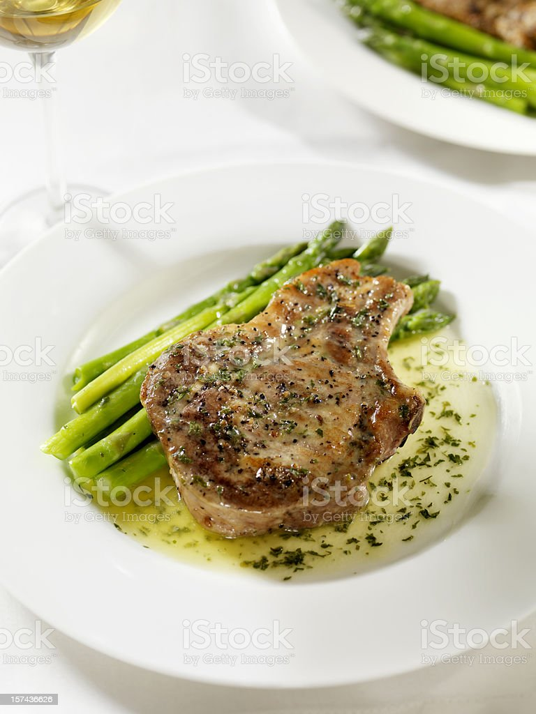 Pork Chop with a Butter Herb Sauce 2 royalty-free stock photo