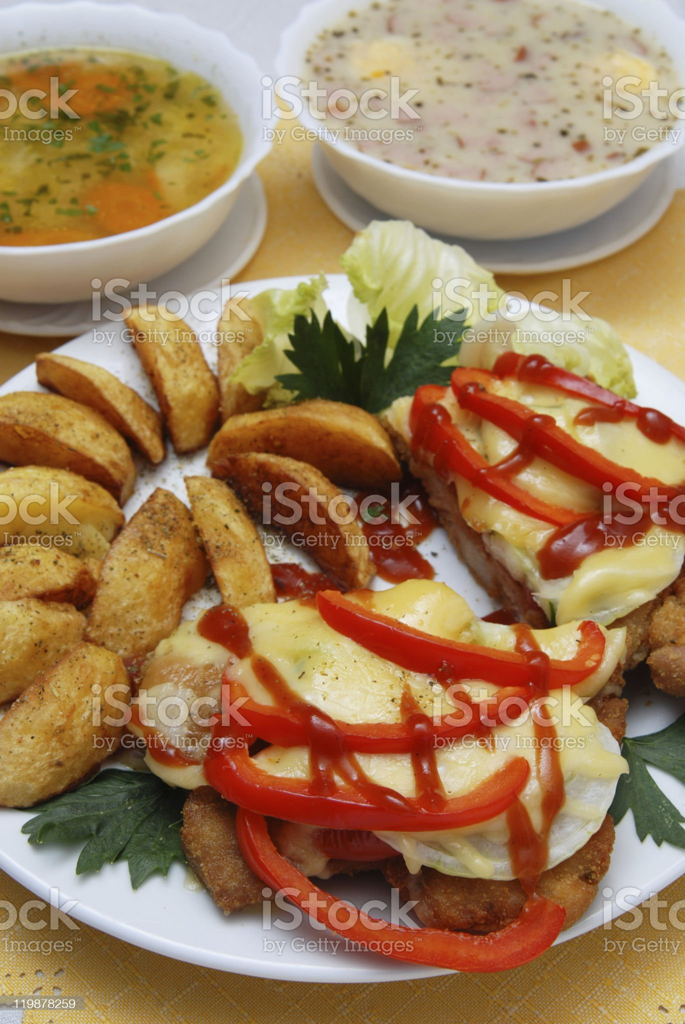 pork chop with cheese and roasted potatoes royalty-free stock photo