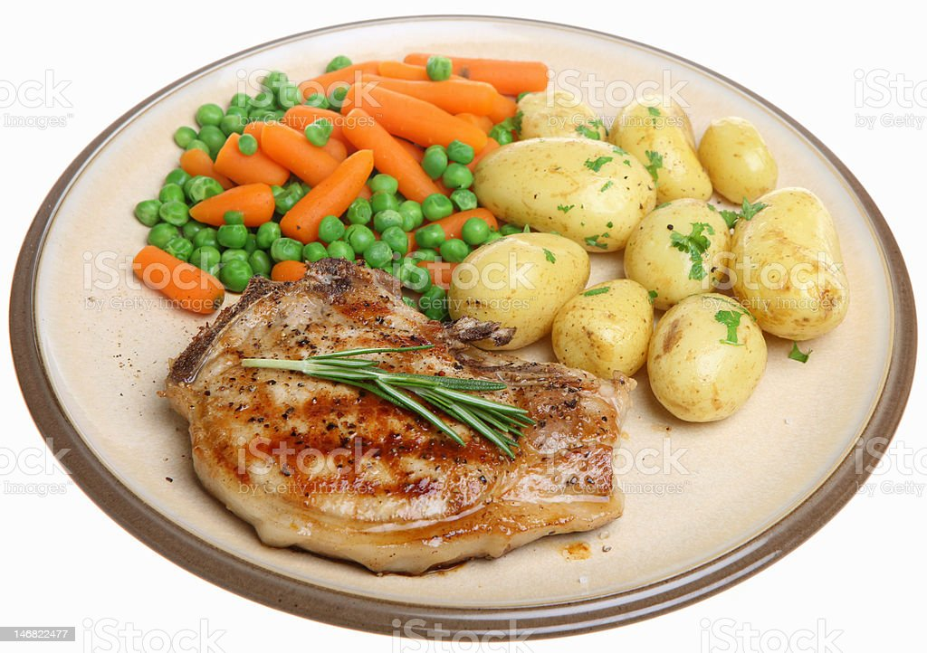 Pork Chop with New Potatoes and Vegetables royalty-free stock photo