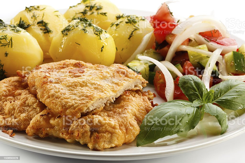 Pork chops, boiled potatoes and vegetables stock photo