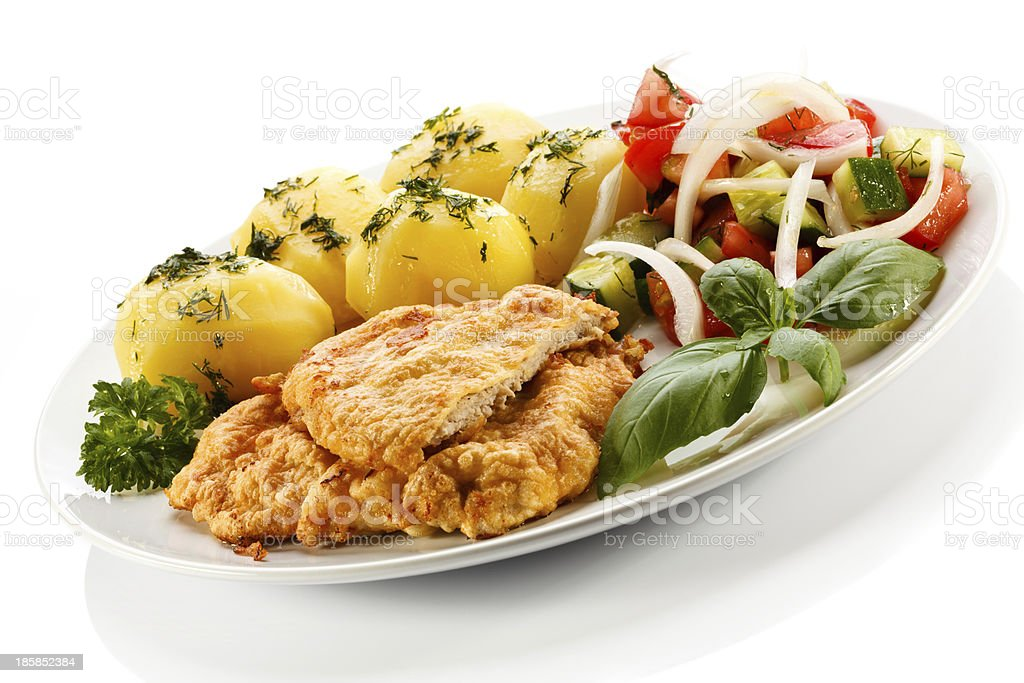 Pork chops, boiled potatoes and vegetables royalty-free stock photo