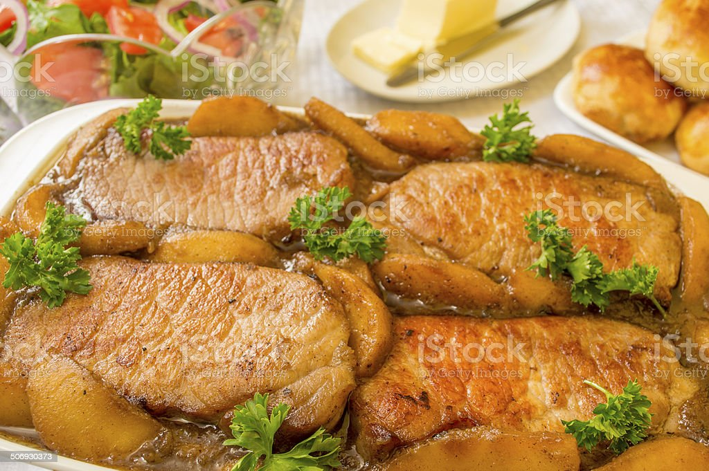 pork chops cooked with a apple compote royalty-free stock photo