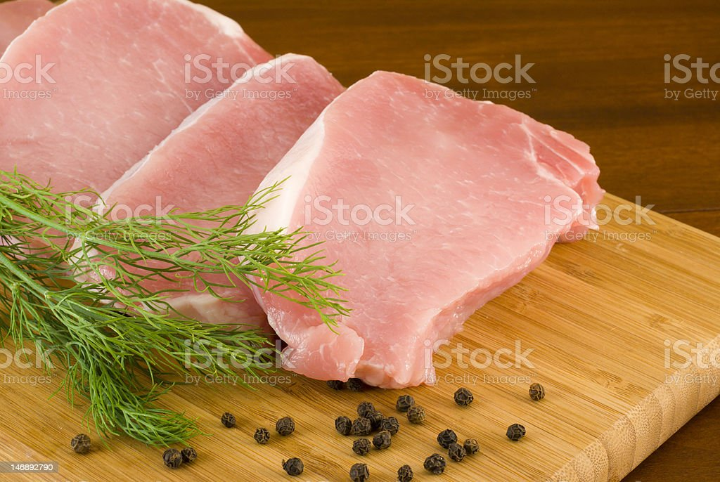 Pork chops , dill and black pepper royalty-free stock photo