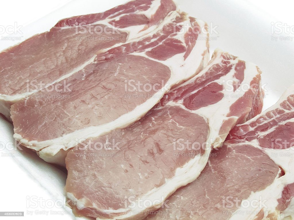 Pork chops packed in a container royalty-free stock photo