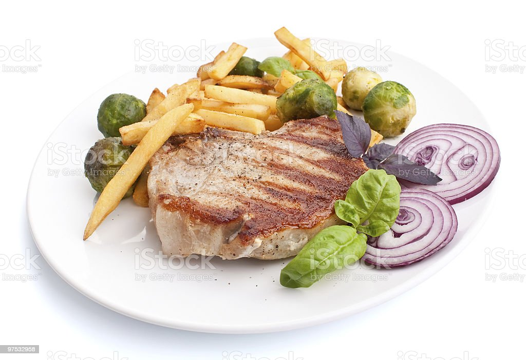 pork chops with french fries and brussels sprouts royalty-free stock photo