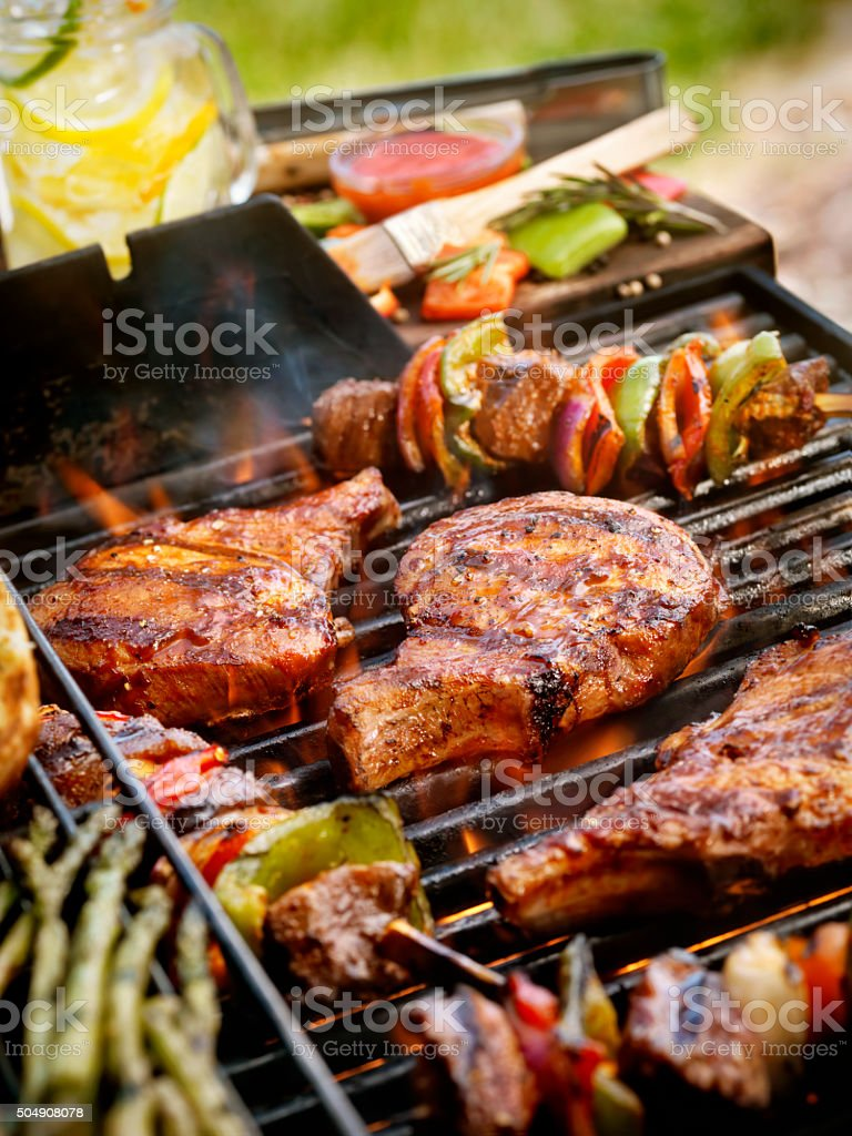Pork Chops with Kabobs on the BBQ stock photo