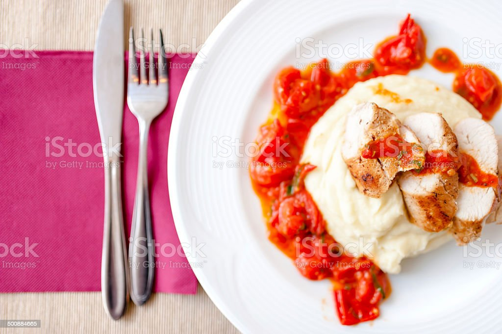 pork chops with mashed potatoes and spicy tomatoes sauce stock photo