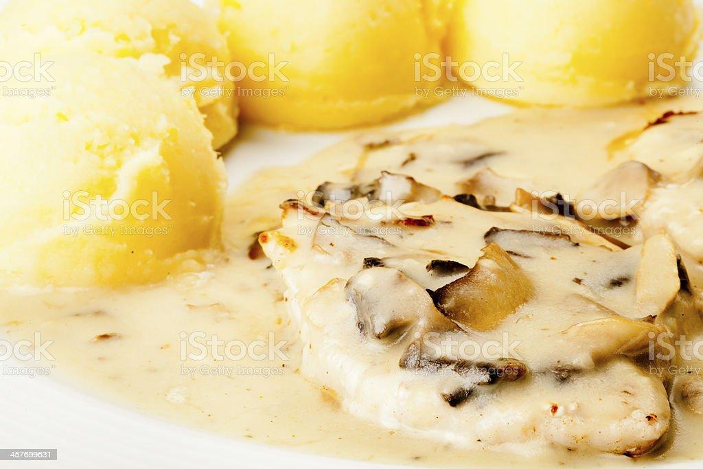 Pork Chops with mushroom sauce and mashed potatoes stock photo