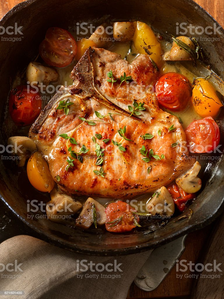Pork Chops with Tomatoes and Mushrooms stock photo