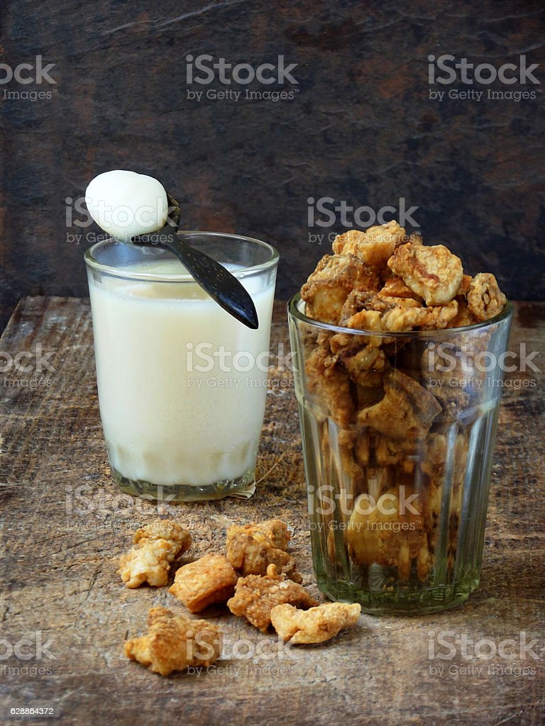 pork crackling, scratchings, various fried bacon and lard in glass stock photo