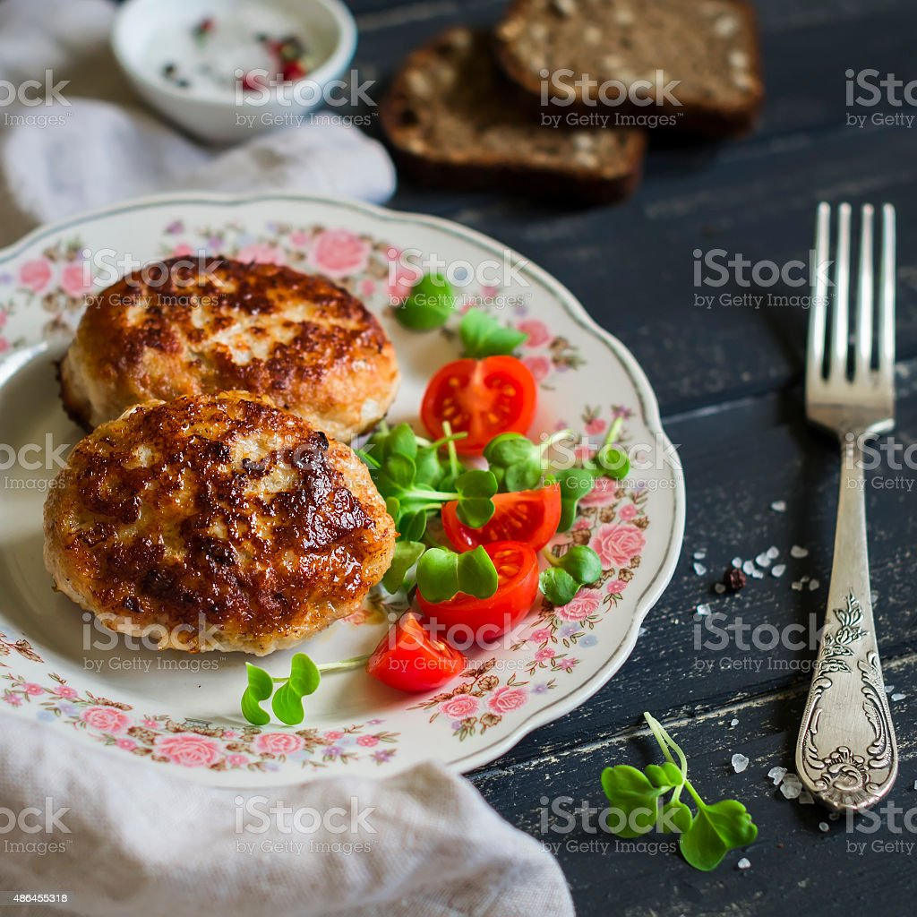 pork cutlet and vegetable salad on a dark wooden background stock photo