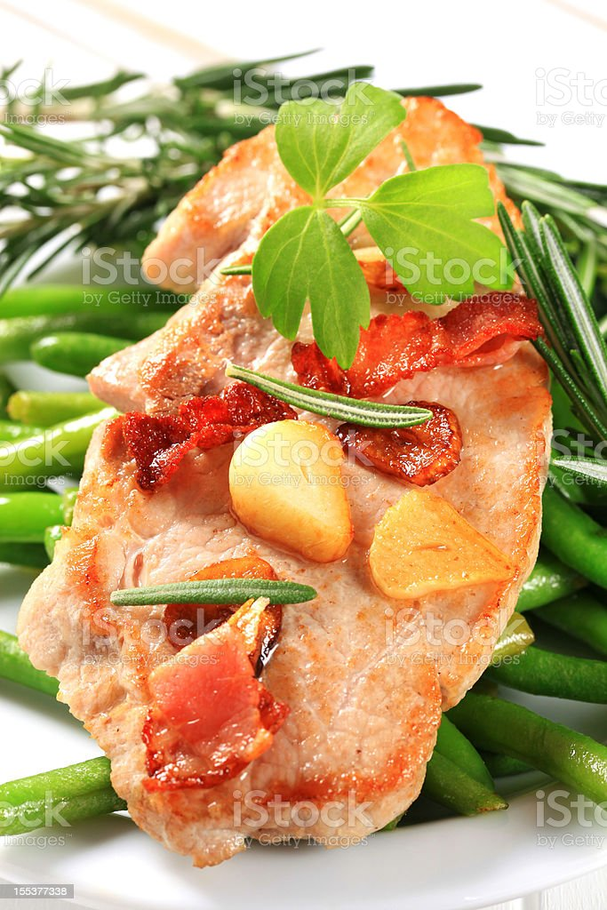 Pork cutlet with green beans royalty-free stock photo