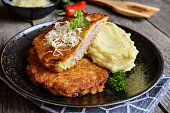 Pork cutlets coated in potato batter, served with mashed potatoes