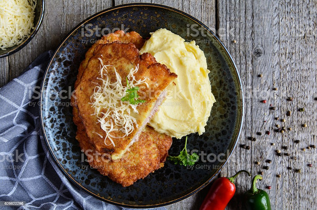 Pork cutlets coated in potato batter, served with mashed potatoes stock photo