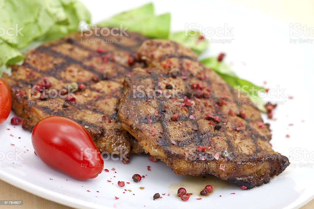 pork cutlet-steak- with lettuce royalty-free stock photo