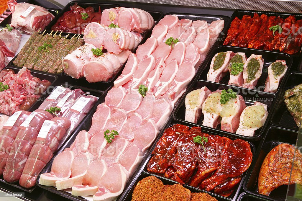 Pork Display in Butcher Shop stock photo