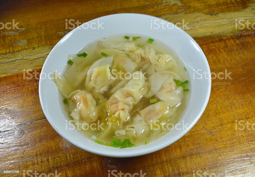 pork dumpling in clear soup on bowl stock photo