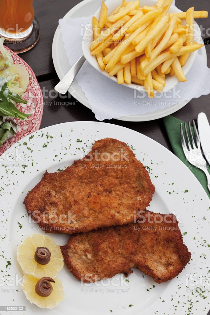 Pork escalope with chips,close up stock photo