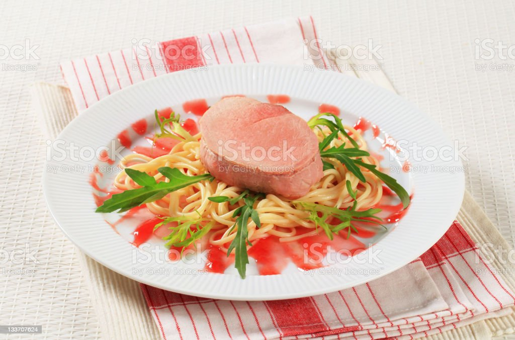 Pork fillet with spaghetti royalty-free stock photo