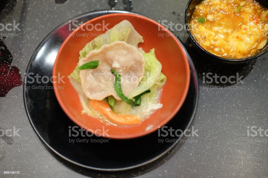 Pork for shabu and yakiniku on red bowl stock photo