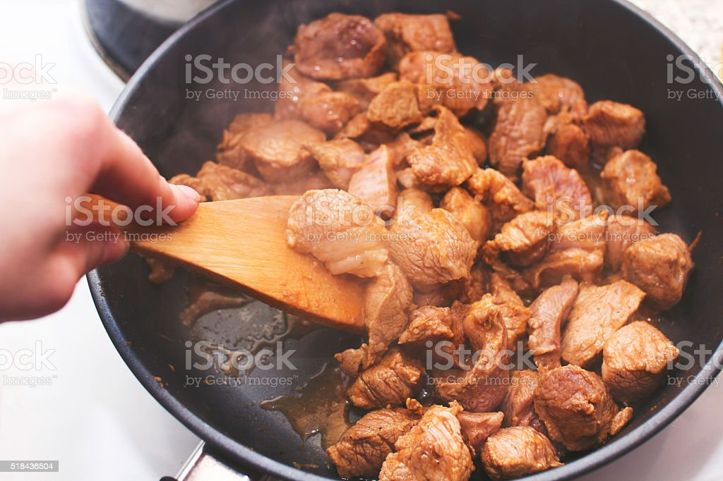 Pork fried in a pan stock photo