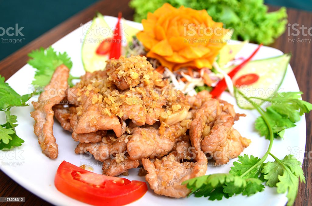 Pork fried with sesame and garlic stock photo