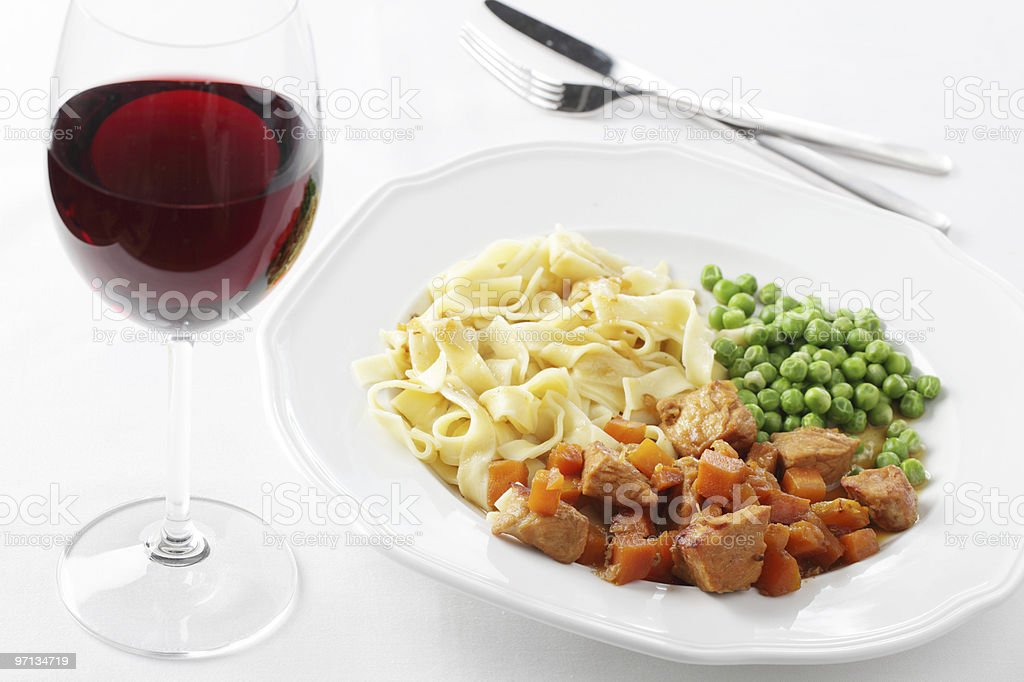 Pork goulash and red wine royalty-free stock photo
